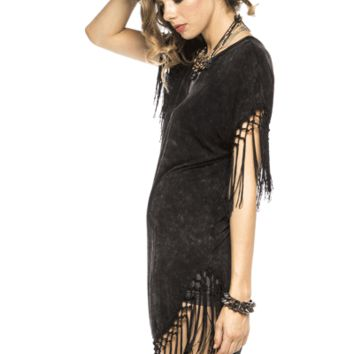 Never go out of style in the Fringe Acid Washed Dress. This dress features acid washed faded black, round neckline, short sleeves with fringe detail, shift dress construction, and finish with asymmetrical bottom hem with fringe detailing. Pair with faux le
