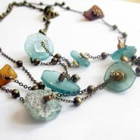 Roman glass necklace with brown seaglass, glass, and foil beads long