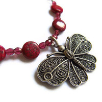 Dragons Blood gemstone and Antique Butterfly by PinkCupcakeJC