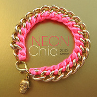  Hot pink neon bracelet. Vibrant pink neon bracelet on gold chain. Neon silk knotted bracelet for Summer 2012 by Karman Jewelry.
