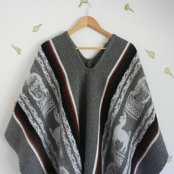 vintage poncho / wearable blanket / alpaca wool / fringe / woven / fall + winter / grey / unisex