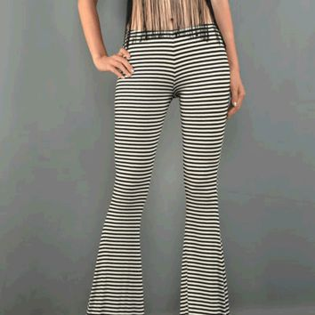 Show off your hip look in the Sweet Lola Stripe Knit Bell Bottom. These fitted and flare knit pants feature stretch knit material, elastic waist band, wide leg fit, and finished with stitching detail.