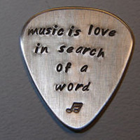 Aluminum Guitar Pick Handmade with the saying Music is Love - Nici's Custom Guitar Picks and Jewelry