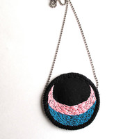 Embroidered pendant necklace with pink and blue crescent design on black twill with silver ball chain circular pendant Fall fashion