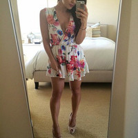 Cultivating floral Playsuit – Sirenlondon