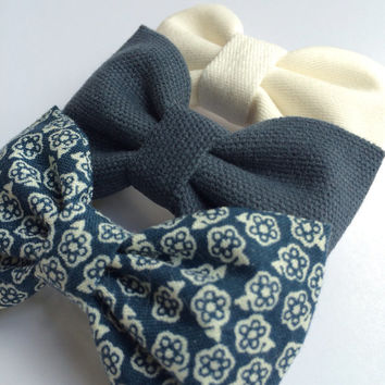 Winter white, textured blue, and tiny white on blue floral hair bow set from Seaside Sparrow. These hair bows make a perfect gift for her.