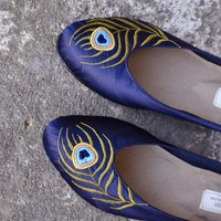 Indigo flats with a peacock embroidery