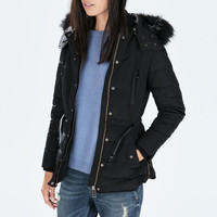 Mid-length puffer jacket with fur hood