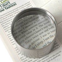 Page 1 Magnifier + Paperweight