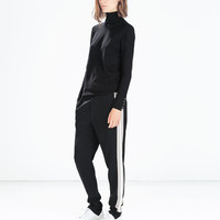 Cuffed trousers with side stripes