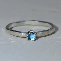 Sterling silver hammered stack ring with blue topaz