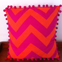 Zigzag ethnic inspired appliqued cushion with bobble trimming