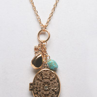 Bows and Bobbles Locket Necklace | Wet Seal