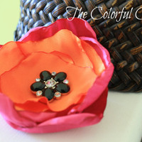 "Orange satin and fuchsia crushed satin w/ a 28mm black rhinestone button in d center on a black 3/8"" elastic.Baby headband.Photo prop"