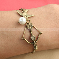 The Hunger Games charm bracelet, Katniss bow  with Mockingjay and Peeta pearl Bracelet inspired by The Hunger Games