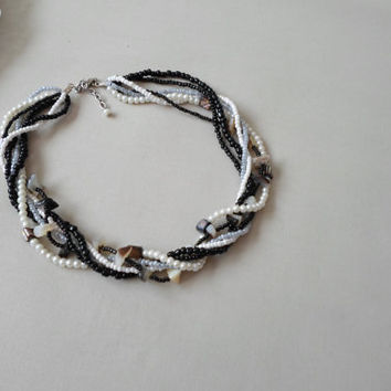 Pearl necklace, Multistrand Beads Necklace.  Sead beads necklace. White, black, gray, seeds beads and black mother of pearls
