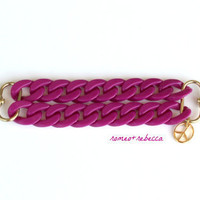 plum acrylic double strand bracelet with peace charm