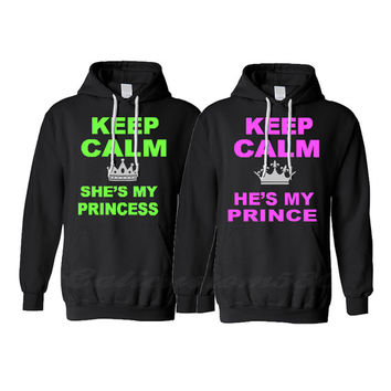 "2 black matching hoodies featuring ""keep calm she's my princess ""  ""keep calm he's my prince"""
