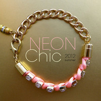 Neon pink braided charm bracelet with rhinestones. Pink neon rhinestone bracelet on gold chain. Neon jewelry.