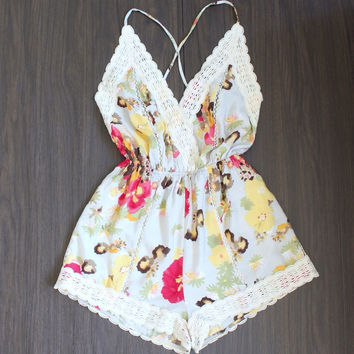 A floral affair romper | yellow
