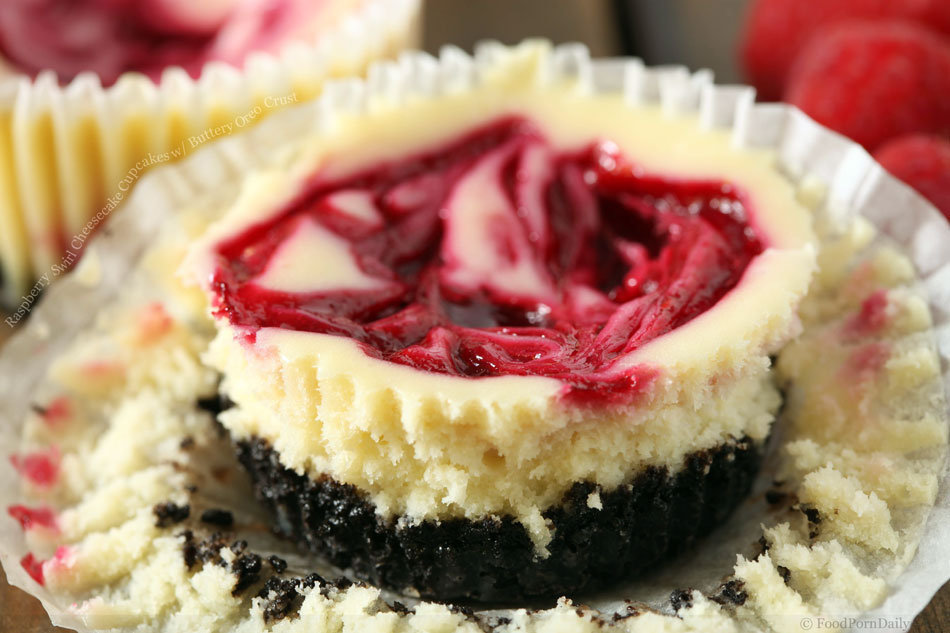 Raspberry Swirl Cheesecake Cupcakes with from foodporndaily.com