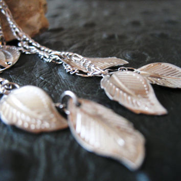 Long silver plated studs with leaves