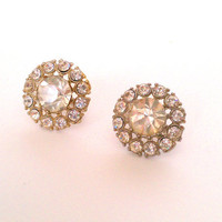 vintage rhinestone cluster clip on earrings - circle of small rhinestones around large sparkly gem on silver tone screw back setting