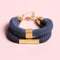 Navy bracelet with gold beads