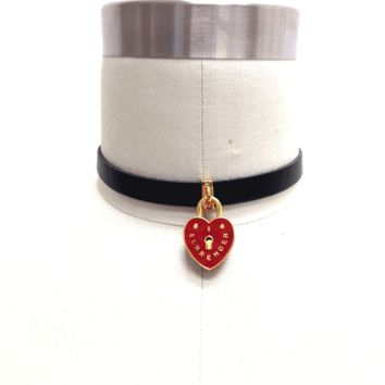 """I Surrender Choker makes you all choked up cause you won't ever wear yer heart on yer sleeve again. This sick choker is totes 90's with it's red enamel heart locket with """"I Surrender"""" printed on the face and Me and Zena printed on the back so you know it's"""