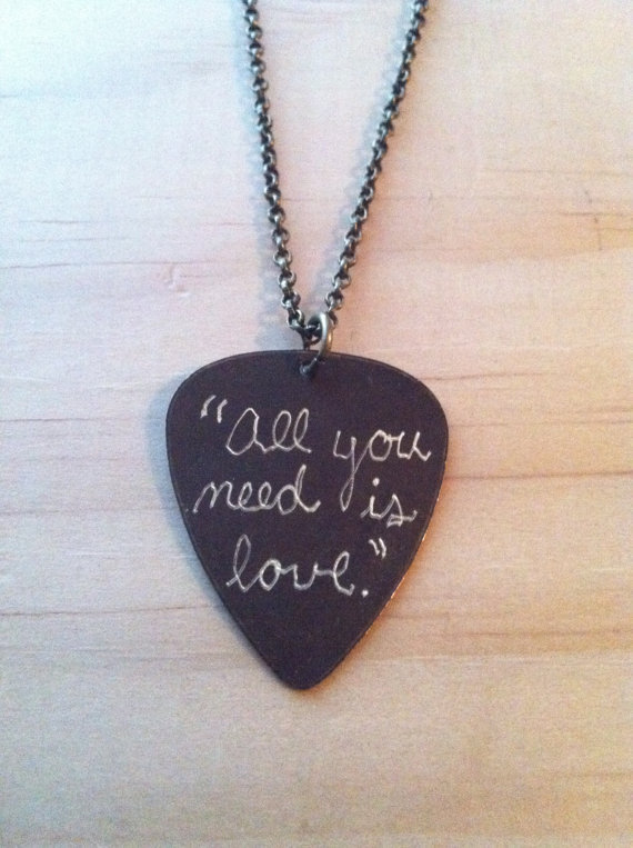 "Engraved Brass Guitar Pick Necklace - The Beatles song lyric ""All you need is love"""