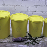 Vintage Tupperware Canisters Set of Four with push down lids Bright Yellow 1970s Kitchen Storage Nesting Stackable
