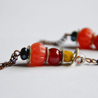 Bead and tassel earrings. Orange, red, yellow and black stones/beads. Vintage nuts &amp; bolts. Copper chain tassel, bronze earring hook