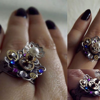 Silver steampunk ring. Featuring crystals, pearls and watch gears. Alice in Wonderland inspired.