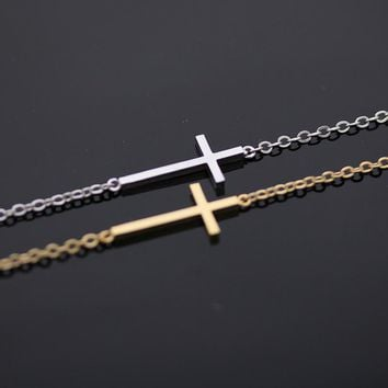 sideways cross + bracelet in gold by bythecoco on Zibbet