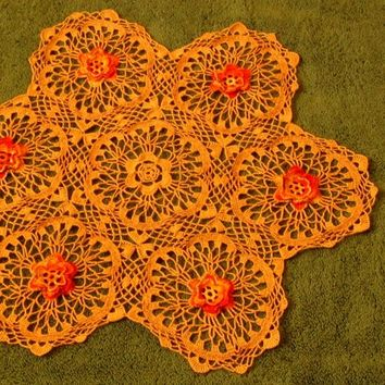 Sparkling Crocheted Lace Tan Centerpiece with Orange - Yellow Flowers