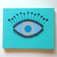 Blue evil eye acrylic canvas painting for girls room, baby nursery, or dorm room.