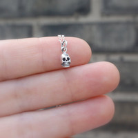 Tiny skull necklace - teeny tiny sterling silver skull charm . sterling silver chain . Halloween jewelry . goth & rocker chic