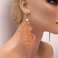 Jonquil lace earrings pottery orange