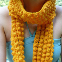 Woman's crochet winter scarf in yellow