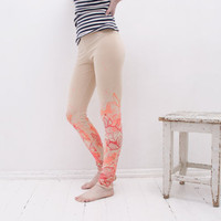beige orange fancy animal print leggings