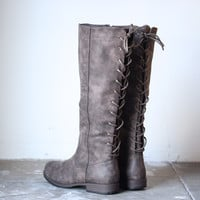 laced up weathered riding boots , taupe