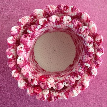 Two crocheted baskets for baby changing table in pink and white with buttons