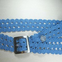 A blue crochet belt in bruge lace pattern