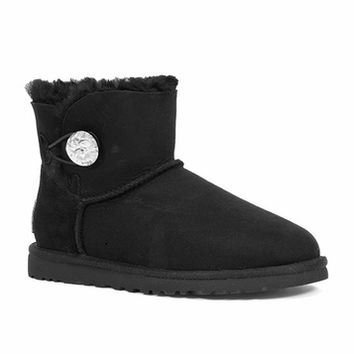 Free Shipping on the UGG Women's Mini Bailey Button Bling Boot. The mini Bailey Button silhouette has a transformed look with a functional side button decorated with a genuine Swarovski crystal. | WhatSheBuys