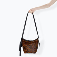 Leather bucket bag with fringes