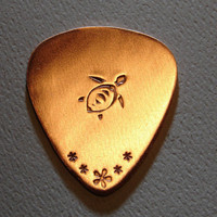 Copper guitar pick with sea turtle