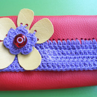 Leatherette Coin purse...Red and light purple very practical coin purse...Pouch closes with a decorative snap.