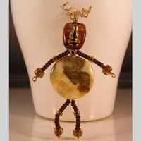 Ivory and Brown Feldspath and gold wire beaded Tiki person pin