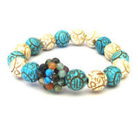 Carved Magnesite and Mixed Stone Stretch Bracelet in turquoise, ivory and earth tones