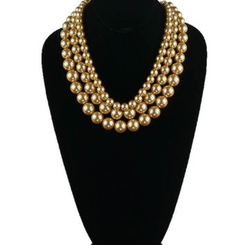 Three Strand Gold Pearl Necklace